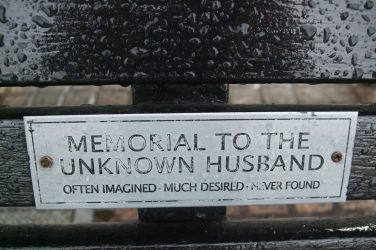 the plaque on the bench reads Memorial to the Unknown Husband