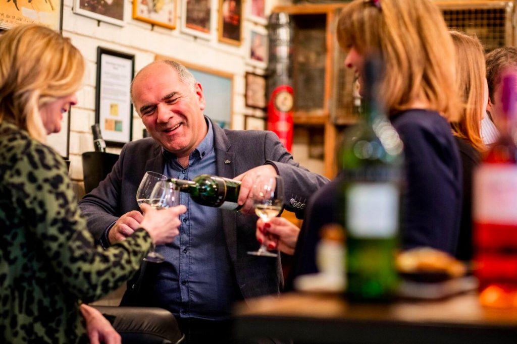 People pour wine inside Feria de Londres