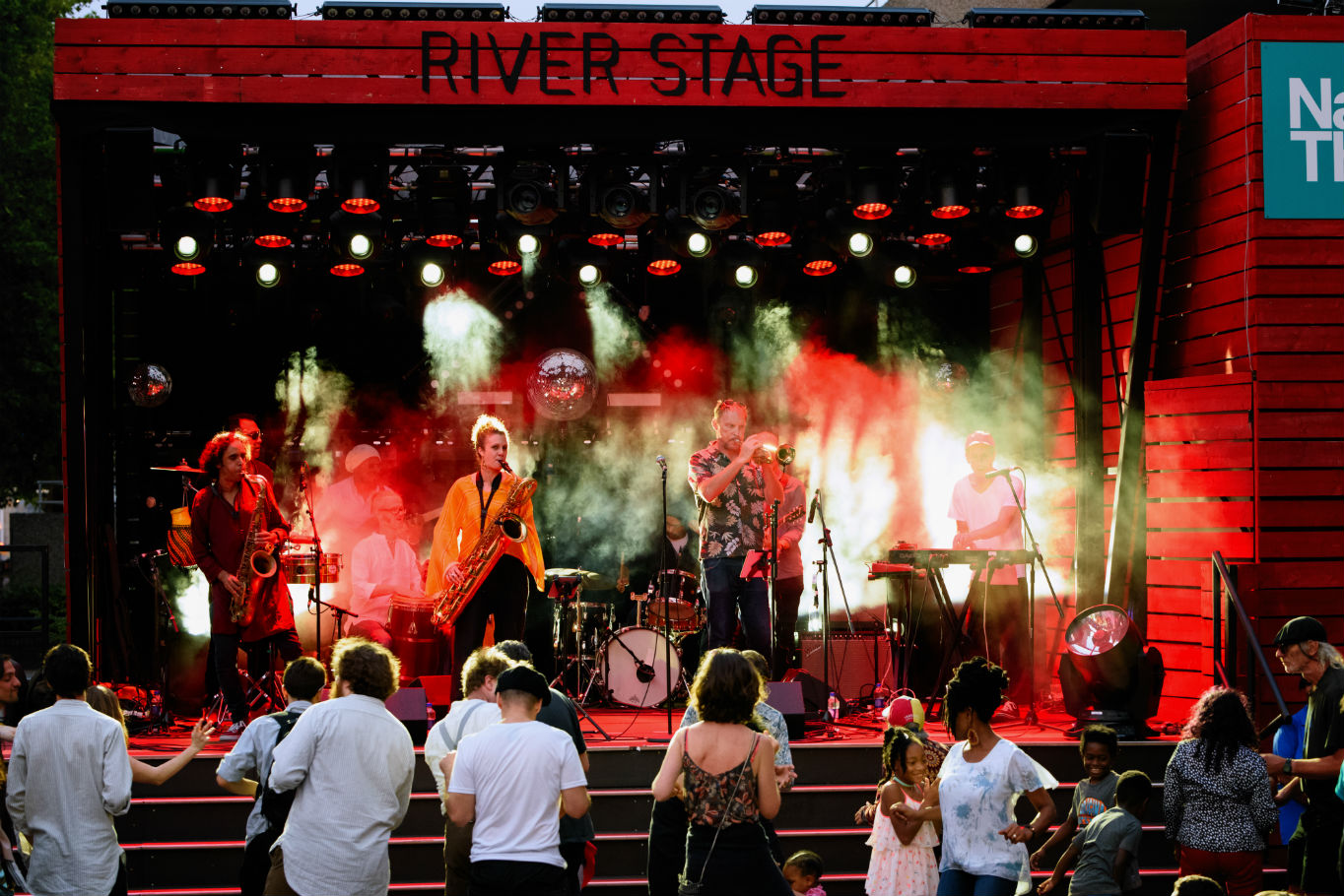 Band performing on River Stage